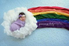 Newborn baby girl sleeping on cloud with rainbow. Rainbow baby. Precious Baby Photography, Fort Wayne, Indiana. www.preciousbabyphotography.com scene