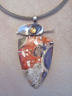 Contemporary Art Jewelry -  Hand made jewelry by american art studio jeweler Lesley Aine Mckeown.   Specializing in one of a kind soul stirring   art to wear.