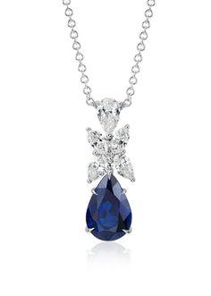 This pendant features an exquisite vivid royal blue 5.01 carat pear sapphire featuring brilliant marquise diamonds.