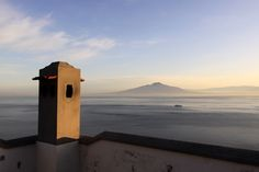 Looking towards Mount Vesuvius across the Bay of Naples from a roof top terrace on the Sorrentine Peninsula, Sorrento, Campania, Italy
