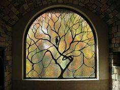 Magical stained glass window for a magical house! By Cain-White Architectural Art Glass.