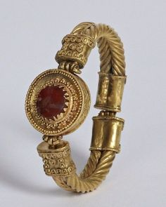 Antique Jewelry Greek Gold and Garnet Bracelet, Hellenistic, Century BCThe most distinctive feature of this bracelet or armlet is the treatment of the outer surfaces of the hoops. Decorative elements are covered. Greek Jewelry, Sea Glass Jewelry, Gold Jewelry, Jewelery, Jewelry Accessories, Fine Jewelry, Jewelry Design, Stylish Jewelry, Jewelry Ideas