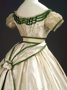 Girl's formal evening dress with sash, 1867. It is a House of Worth. Girl's formal evening dress with sash Charles Frederick Worth (1825 - 1895) Silk taffeta trimmed with bands of bright green silk satin, white silk lace and sheer silk tabby net 1867