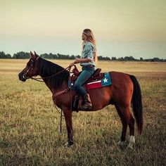 Red, white and blue saddle pad. Love it, but this picture bothers me because her seat is way too big for her.