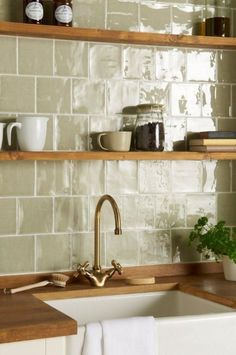 Mere field tiles in an offset pattern From the Cosmopolitan range at The Winchester Tile Company Handmade ceramic tiles made in the UK # Kitchen Wall Tiles, Kitchen Shelves, Kitchen Backsplash, Backsplash Ideas, Kitchen Cabinets, Colourful Kitchen Tiles, Kitchen Sink, Patterned Kitchen Tiles, Penny Backsplash