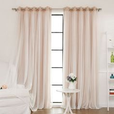 Lend a touch of elegance to your master suite or guest room with this lovely curtain, featuring a light-blocking design with sheer lace overlay. …