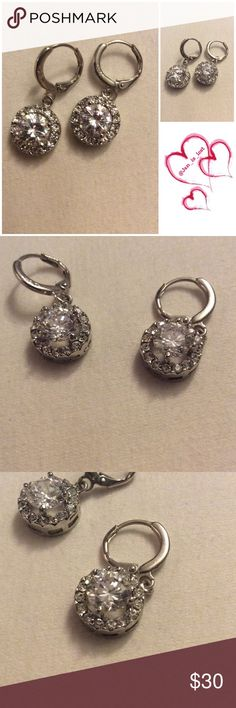 """2CT CZ Earrings 2 ct CZ earrings set in a silver setting. (Could be a little bit more on the ct weight, not sure) approx 2"""" height Jewelry Earrings"""