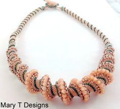 This lovely spiral necklace was beadwoven with love one bead at a time using peach, pink and moss green beads of varying sizes and finishes. It is finished with a beadwoven toggle clasp and is 20 long when fastened.    To see more of my designs, visit http://www.etsy.com/shop/beadwoven    Interested in something similar?? Contact me and we can work out the details.