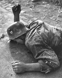 A German soldier lies dead during the Battle for Rome, 1944. Carl Mydans
