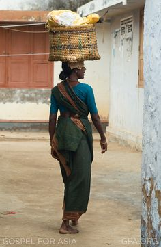 Madhurima Banerjee [not pictured] knocked on yet another door. She stood with a bamboo basket filled with fresh, green vegetables balanced on her head, waiting for someone to open the door and buy the goods she carried. This was how she earned her living. Every day, she went door-to-door selling vegetables, and every day the load became heavier and heavier for her to bear.  Read the rest of her story.