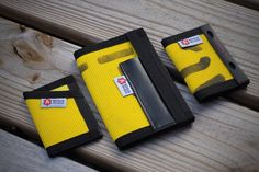 The Sergeant Slim Wallet The Inspector Field Notes Cover and The Rookie minimalist Bifold in Yellow/Black fire hose.
