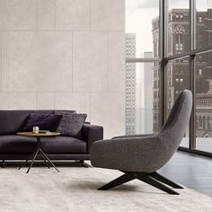 Marlon armchair in removable fabric Sparta 16 ferro, black elm legs.