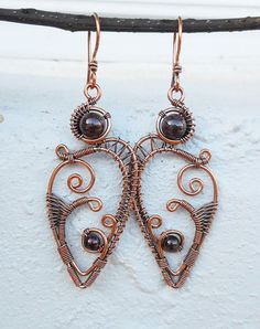 These copper wire wrapped earrings have an otherworldly beauty that's very stylish. I made them using genuine copper wire and dark red Garnet beads. The perfect bohemian earrings if you want to get noticed. One of a kind and handmade by me! * Made with genuine copper wire. If you