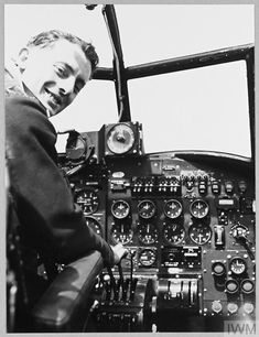 """Original wartime caption: For story see CH.12868 Picture (issued 1944) shows - An Australian airman in the cockpit of """"N"""" for Nuts. He has done ten operational trips. Lancaster Bomber, Caption, Aviation, Trips, Aircraft, Military, War, Viajes, Captions"""