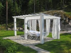 our new white pergola dressed with lace curtains for twin daughters´ birthday party