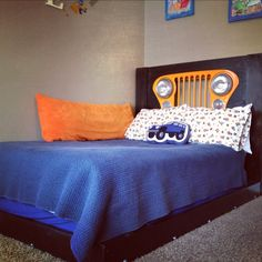 Toddlers headboard made from an old jeep grill.