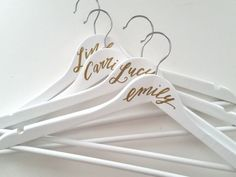 Hand-lettered using gold or silver paint, these prettily personalized hangers make perfect bridesmaid gifts. Bridesmaid Luncheon, Bridesmaid Proposal Gifts, Wedding Gifts For Bridesmaids, Bridesmaids And Groomsmen, Bridesmaid Hangers, Wedding Hangers, Bride Hanger, Personalized Hangers, Gifts For Wedding Party