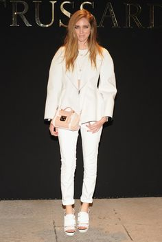 Chiara Ferragni toned down her normally eclectic outfits in favor of this chic all-white Calvin Klein number for the Trussardi show. [Photo by Pier Marco Tacca/Getty Images]