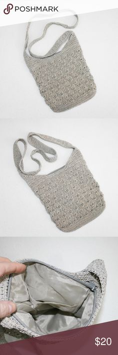 Taupe Crocheted Cross Body Boho Bag This cross body bag is taupe, but has a slight greenish tint to it. Crocheted shell pattern with clear beads woven in. 8 inches deep and 8 inches across, 2 inch wide bottom. Zips closed and has one inside pocket. (0929) Bags Crossbody Bags