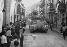 """US 2nd Armored Division enters Palermo, Sicily, 22 July 1943. In """"With Every Letter,"""" Lt. Tom MacGilliver flies into Palermo."""