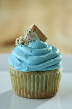 """Pop-Tart Cupcakes--Blueberry Pop-Tarts mixed with vanilla cake batter and topped with a swirl of swiss meringue buttercream tinted blue to match the """"blueberry"""" theme. Kids would like these"""