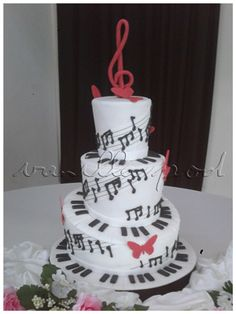 A 3 tier piano and musical notes theme wedding cake in white,black and red. Congratulations to both bride and groom,Nicole and Hadi.For orders or inquiries,please email us at mail@myvanillapod.com