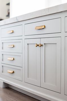 Grey kitchen cabinets with gold drawer pulls // kitchen decor ideas kitchen design cabinet hardware kitchen hardware neutral kitchen feminine kitchen