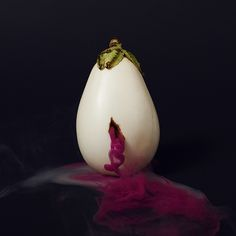 I am captivated by 'The Secret Lives of Fruits and Vegetables', a recent still life series by photographer Maciek Jasik. The thick exteriors of produce are punctured, allowing vibrant smoke to . Secret Life, The Secret, White Eggplant, Illustration Arte, Illustrations, Saatchi Gallery, Colored Smoke, Colossal Art, Grid Design