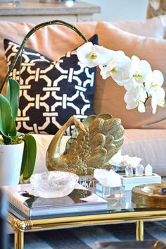 Vintage #brass #swan #planter with a stunning orchid at #Dallas #Mecox #interiordesign #MecoxGardens #furniture #shopping #home #decor #design #room #designidea #antiques #garden