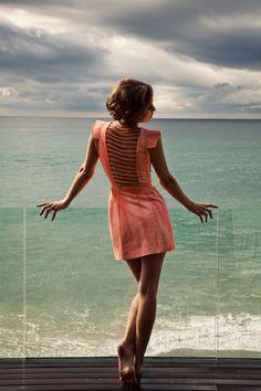 pink dress, blue ocean