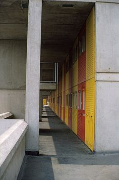 A deck on the Southgate Estate, Runcorn New Town in 1973.  |  Designed by James Stirling. Shows the coloured GRP (fibreglass) cladding to the maisonettes.
