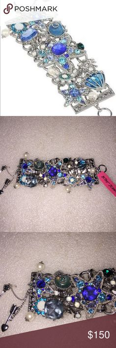 Betsey Johnson bracelet Selling to buy Betsey pieces I need. This is from the nautical collection. The bracelet is silver tone. The charms include starfish,clams,faux pearls and among more. Nwt Betsey Johnson Jewelry Bracelets