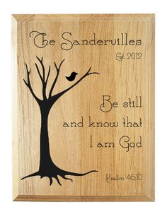 """Family name plaque with Scripture verse. This wood sign features a contemporary-style tree design along with your family's name laser carved into the surface of the Alder wood.    This wood plaque also is inscribed with the Bible verse from Psalm 46:10, which reads, """"Be still and know that I am G..."""