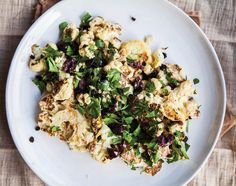 In this recipe from Kimberly Hasselbrink's new cookbook, Vibrant Food, she tosses roasted cauliflower with fresh parsley, Kalamata olives, sweet currants and a lemony, earthy tahini dressing. While this is a recipe from the book's 'Winter' chapter, it's light and accessible enough to work year-round.