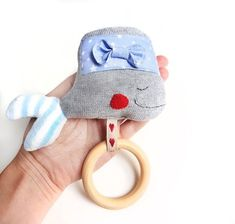 Baby teether with a wooden ring and whale toy. Via en.DaWanda.com.