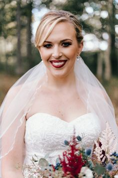 Dramatic smoky eye, wine colored lip, elegant bridal up-do hairstyle, wedding day beauty ideas // Erin Morrison Photography