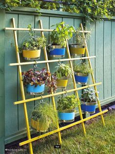 Still like this the best. Simple enough to make. The planters hang straight down. Could have vines crawling all around.
