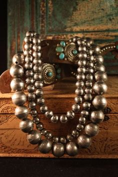 Navajo pearls ~love the patina of the jewelry and how it is photographed with the soft patina of aged wood. jewelry for women http://amzn.to/2jxzGM6