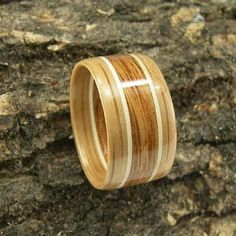 This beautiful Bentwood Ring is made with American White Oak and English Brown Oak with Holly strips. The ring in the photo is size 11 and is 12.5 mm wide. This one is available in sizes 4 to 14.5.  J