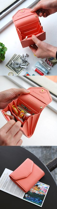 Wallet? Clutch? Card case? The All-in-One Leather Mini Clutch is all all of the above and then some! It's super cute and compact, but spacious and sturdy too. It has 2 card slots, 2 flat pockets, 2 wide pockets, 1 cash pocket, and a zippered coin pocket! With its expandable sides, you can fit up to 25 cards horizontally or vertically. Use it to carry anything from gift cards and membership cards to lip balm and earphones! It's the perfect little accessory when you're on the go. Check it out!