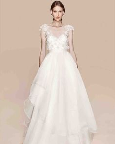 Marchesa Notte Fall 2017 Wedding Dress Collection   Martha Stewart Weddings – Ivory cap sleeved ball gown with 3-D petal embroidered tulle bodice and layers of asymmetric tiered organza