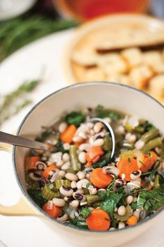 Smoky Field Pea and Greens Soup with Black Pepper Cornbread Croutons. Recipe by Sheri Castle. Photo by Jennifer Hitchcock.