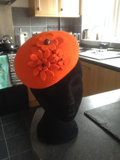 Orange beret with beaded felt flowers