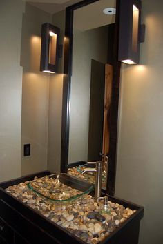 Bathroom ideas--counter top pebbles covered by glass, clear sink and pump spout-- extra long mirrors and great lighting. *** Check out this great article. #homedecorstyles