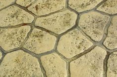 How to Paint a Cement Floor to Look Like Rock