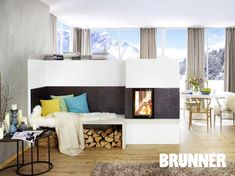 In the apartment in the midst of winter snow-covered idyll, a half-height room divider with fireplace element forms the highlight of the room. He folds a … - Luxery Houses Traditional Tile, Living Room With Fireplace, Modern Fireplaces, Luxurious Bedrooms, Tile Design, Bedroom Decor, Bedroom Headboards, Divider, Bench
