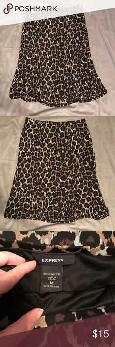 Express Leopard Skirt Size M This skirt is in EUC, no rips, tears, or stains. Express Skirts Midi