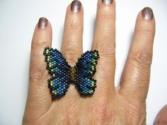 Tutorial Bead Butterfly Ring Lapel Pin Peyote Pattern pdf download by ButterflyBeadKits on Etsy https://www.etsy.com/listing/168457976/tutorial-bead-butterfly-ring-lapel-pin