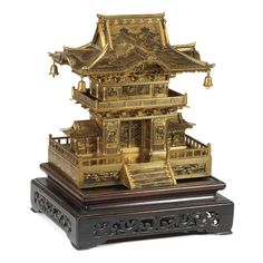 An inlaid iron cabinet modelled as a shrine by the Komai Company, Meiji period | lot | Sotheby's