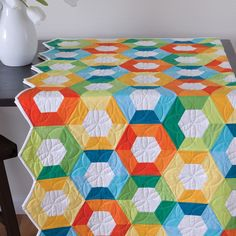 "This pattern is included on the packaging of the die GO! Half Hexagon-1"", 1 1/2"", 2 1/2"" Sides (3/4"", 1 1/4"", 2 1/4"" Finished) (55165)Ready for an updated Grandmother's Flower Garden? Learn the in's and out's of the half hexagon when you make these fun pieced hexagon blooms."